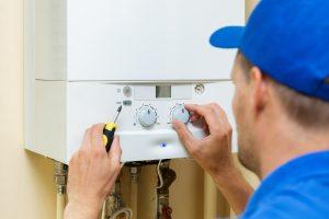 man installing gas heating